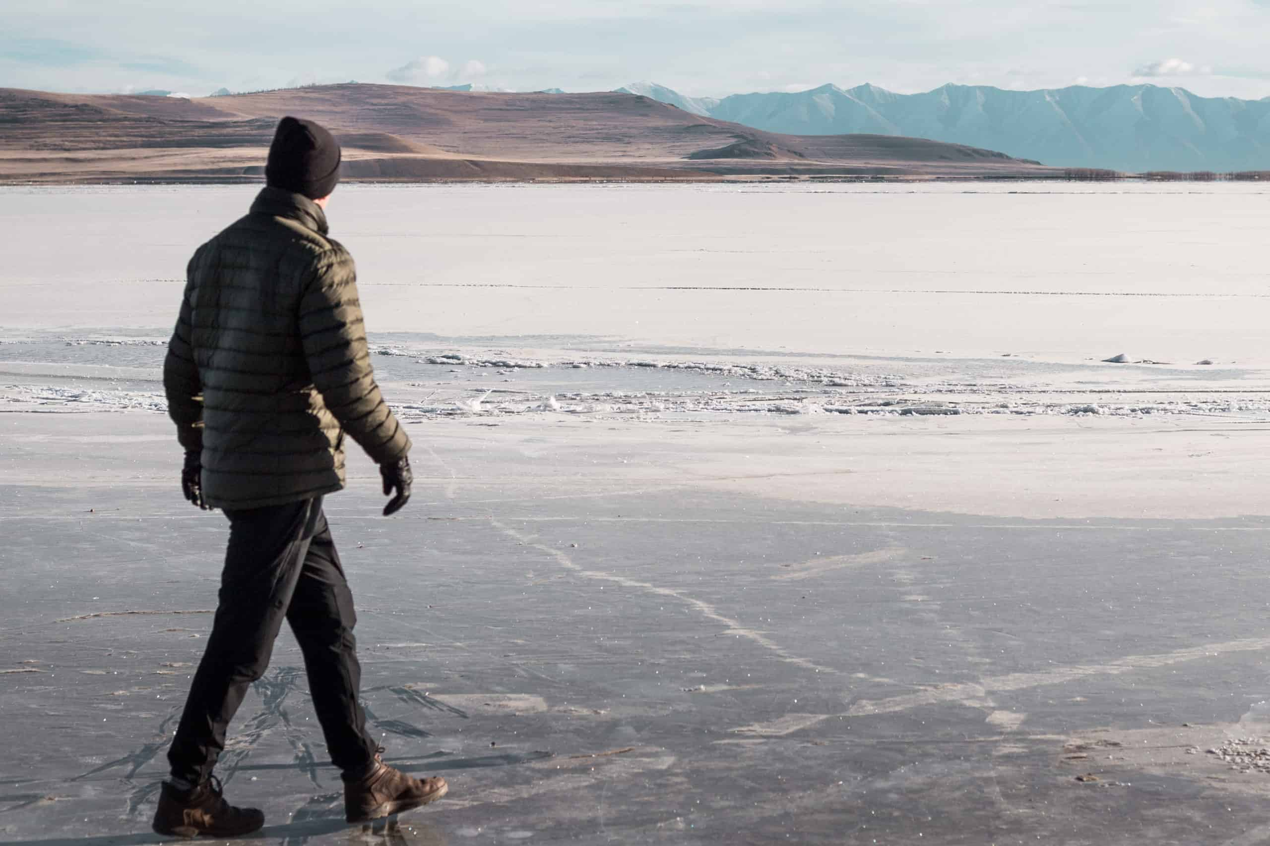 Walking on a frozen lake with warm hat and gloves